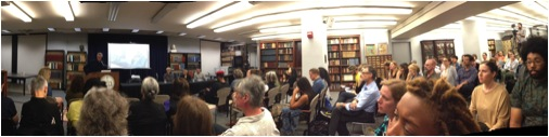At Fales Library, the eager audience waits for the discussion to begin