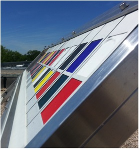 One of the natural aging test racks holding artists' paints.  The customized Weathering rack, made of Aluminum and high-density polyethylene, is positioned to the south and at a 45° tilt for maximum sunlight on the surface of the samples.