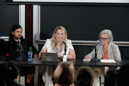 """A photograph of Alfredo Salazar-Caro, Tina Rivers Ryan, and Jill Sterrett sitting at a table in front of an audience at NYU's """"It's About Time!"""" Symposium"""