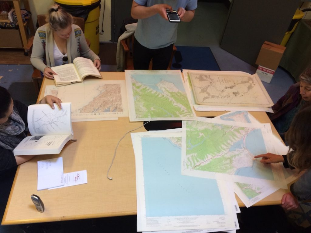 Melinda Stone examines the Prelinger Library's map collection with her University of San Francisco students