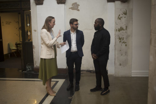 Lauren Shadford, Chad Alligood, and artist Derrick Adams speak to one another in the Stony Island Arts Bank in Chicago