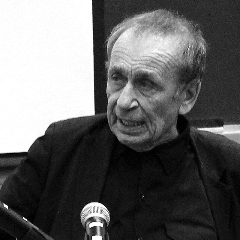 A black and white photo of Vito Acconci